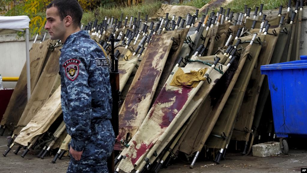 A policeman walks past blood-stained stretchers at a morgue in Stepanakert, the main city in Nagorno-Karabakh, on November 6.
