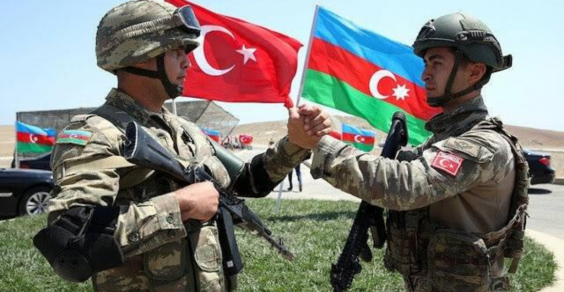 Turkish soldier greets an Azerbaijani colleague during recent military exercises between the two countries (photo TRT Istanbul)